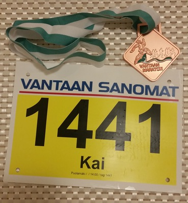Bib number and finisher's medal